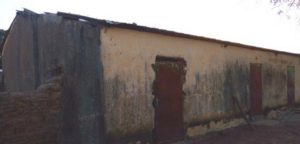 Building in Doumanaba where children are attending school. It was originally built as a warehouse and does not have adequate light or ventilation.