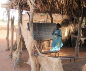 A makeshift, open-air classroom in Nimporodioula where children took classes before the new school was built